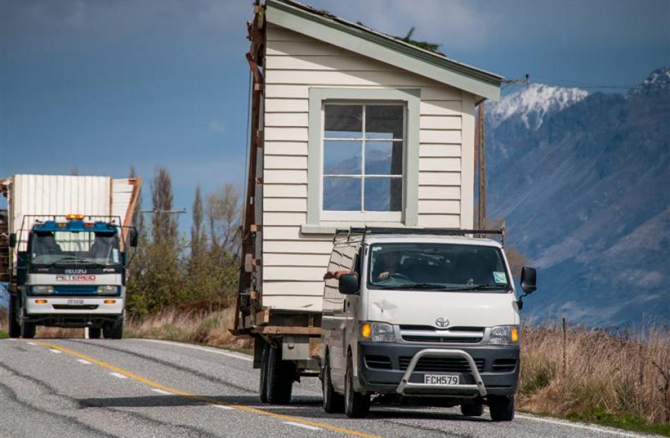A piece  of the former Glenorchy school house is transported to a new site at Paradise, 20km away...