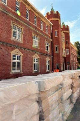 A pile of new mattresses sits outside Selwyn College, which is being refurbished and earthquake...