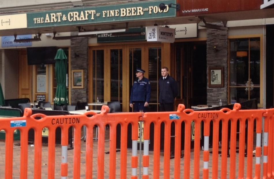 A police officer and security guard at the entrance to Craft. Photo by Hamish McNeilly