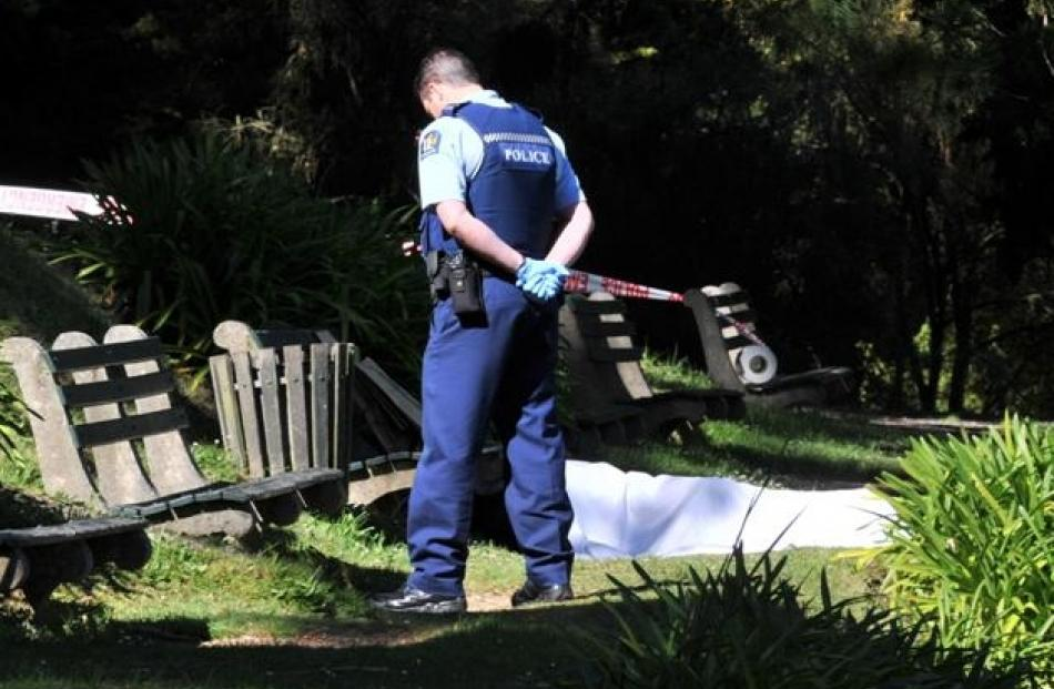 A police officer guards the site where the body of a  Dunedin man was found in the Dunedin...