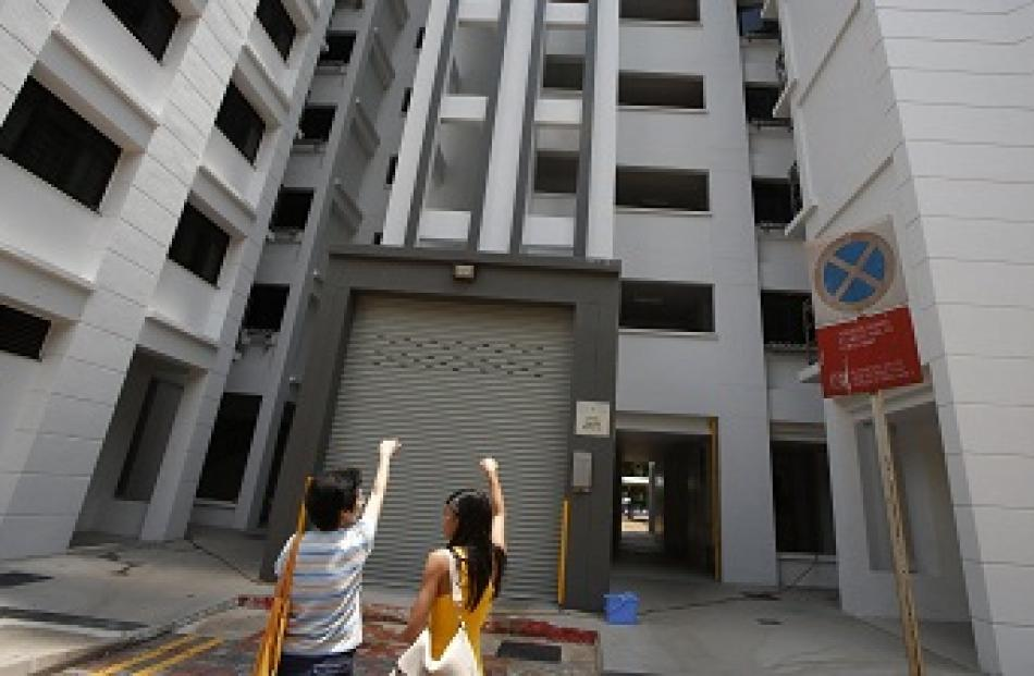A resident shows where she said the body of Autumn Radkte, chief executive of First Meta Pte Ltd,...