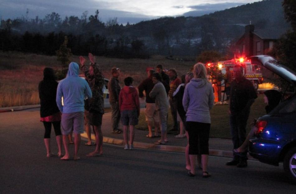 A scrub fire this morning meant an early start for some Wanaka residents. Photo Marjorie Cook