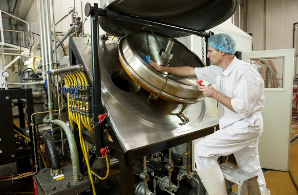 A Sea Dragon technician cleans fish-oil refining equipment in Richmond, Nelson. Photo supplied.