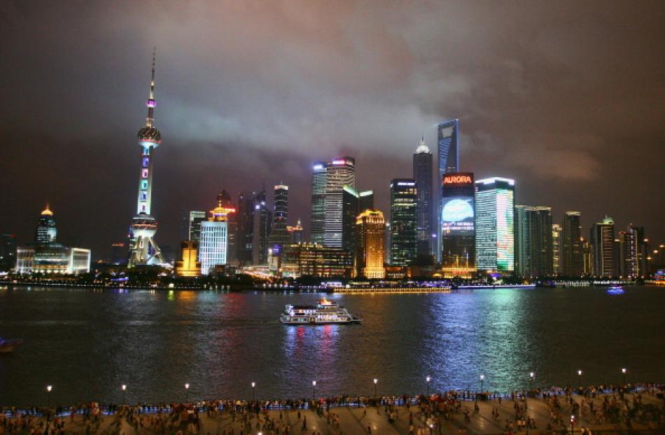 A sightseeing ship on the Huangpu River in Shanghai. China's economic growth is creating...