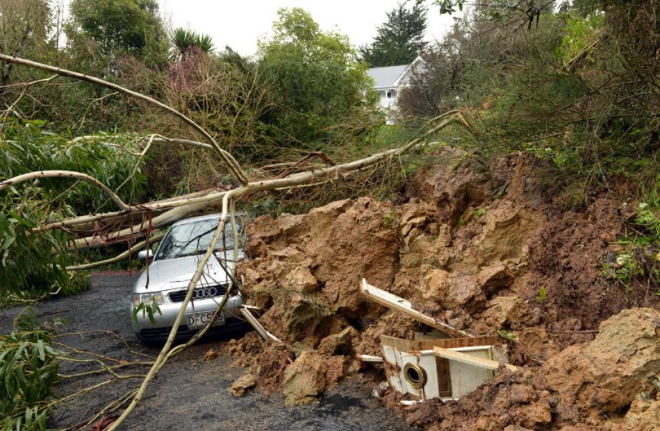 A slip in Blanket Bay, Dunedin, brought down this hillside damaging a house and car.
