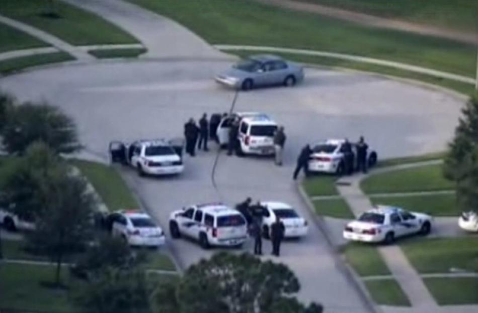 A still image taken from KPRC-TV aerial video footage shows police and a suspect in a standoff at...