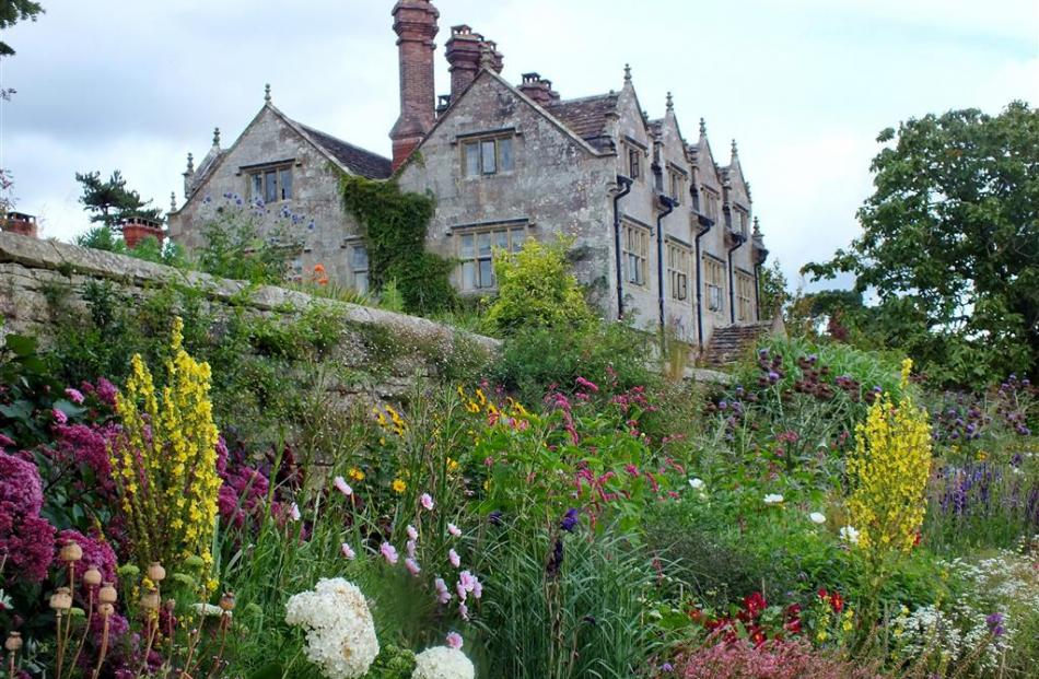 A stone wall at Gravetye Manor with a long bed of perennial flowers at its base. Photos: Gillian...