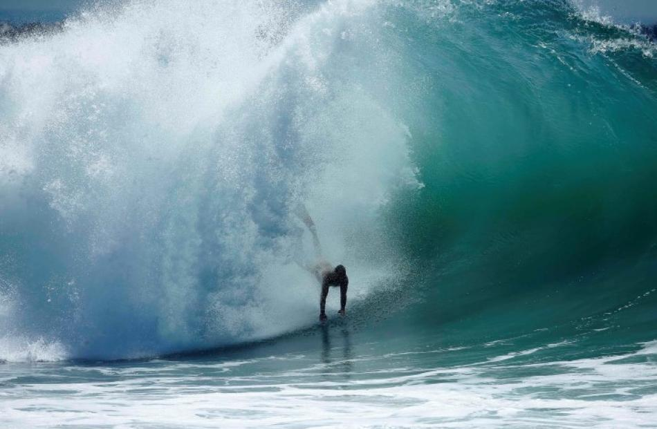 A swimmer catches a wave at 'The Wedge' wave break in Newport Beach, California. REUTERS/Lucy...