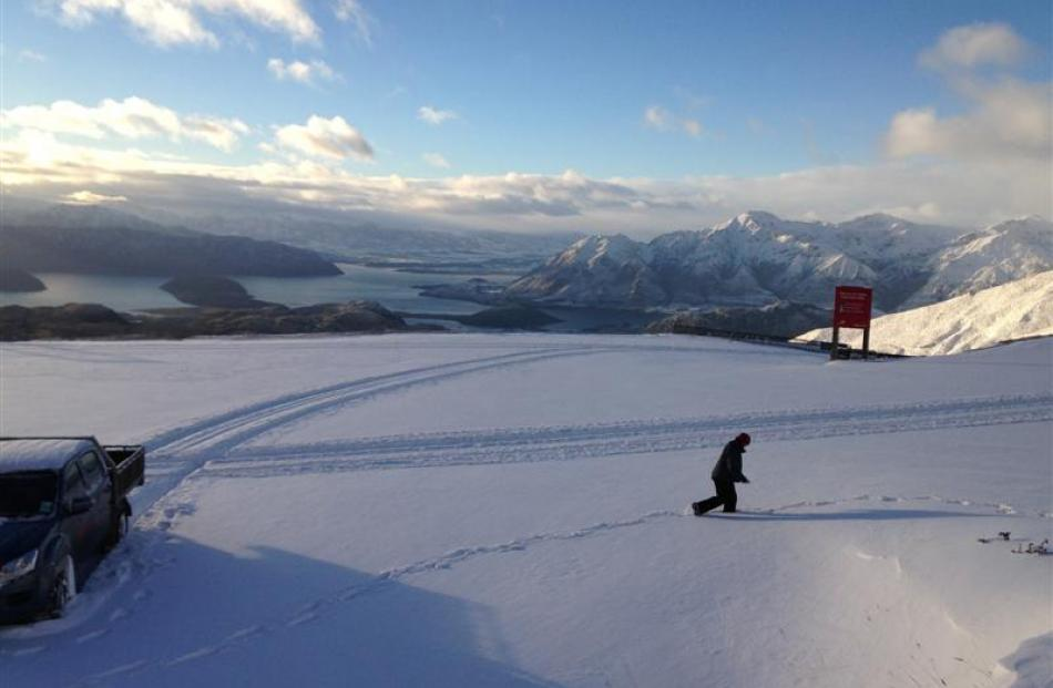 A Treble Cone employee checks the depth of new snow on the field  yesterday . Photo by Rebecca...