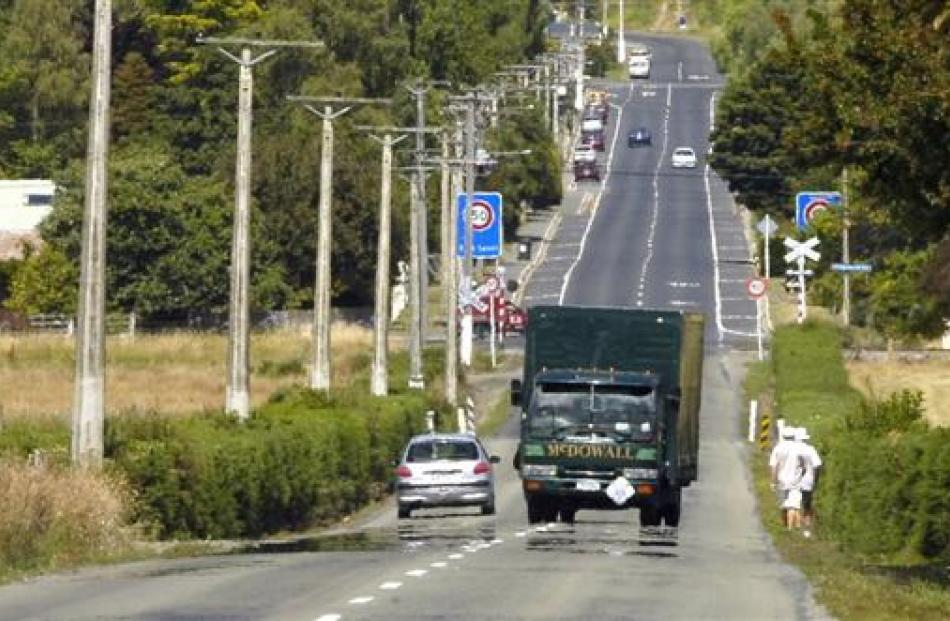 A truck drives along Riccarton Rd, which could be an alternative freight route in the future....