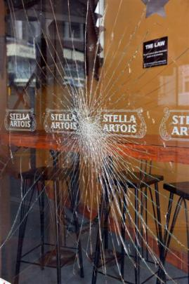 A window was smashed at the Isis bar in Princes St after the death of a Dunedin man in an Octagon...