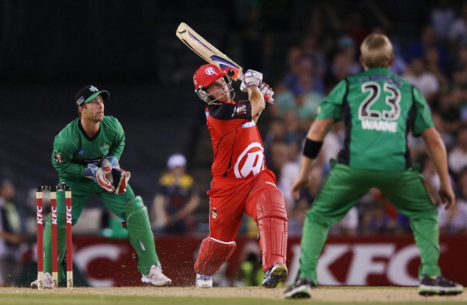Aaron Finch of The Renegades hits Shane Warne of The Stars for six by during their Big Bash...