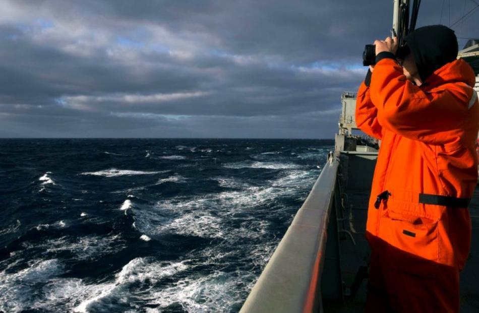 Able Seaman Marine Technician Matthew Oxley stands aboard the Australian Navy ship the HMAS...