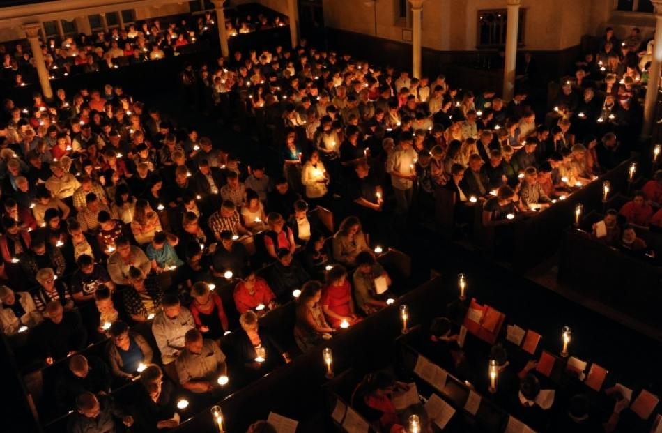 About 800 people celebrate the festive season by candlelight at Knox Church on Christmas Eve....