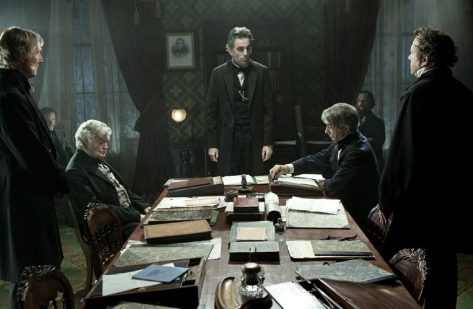 Abraham Lincoln (Daniel Day-Lewis) meets with his cabinet in a scene from Lincoln.