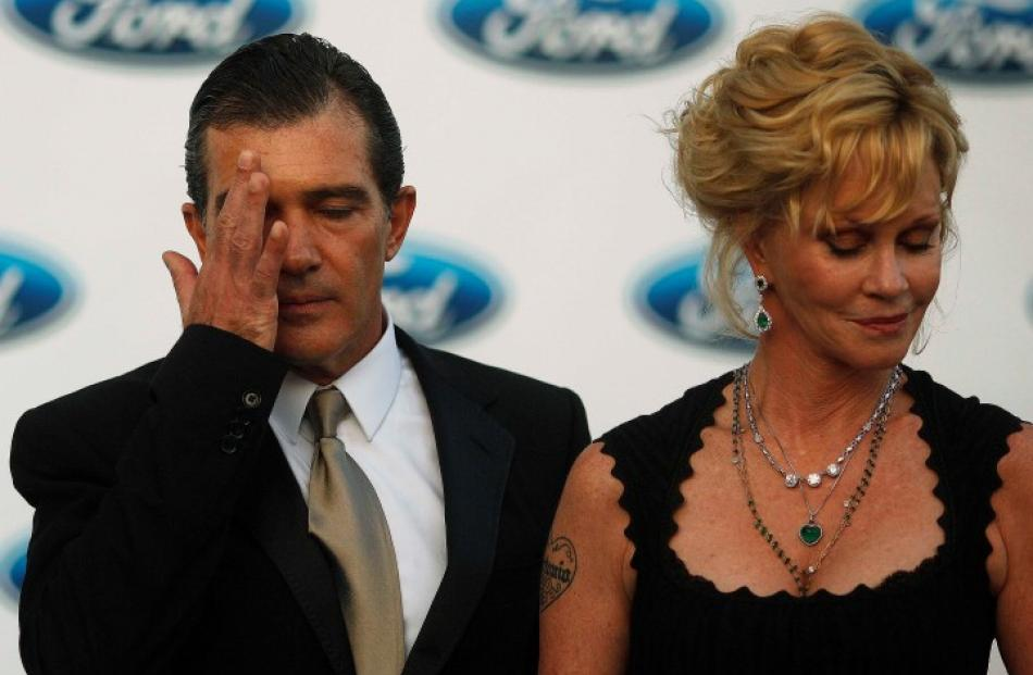 Actor Antonio Banderas and his wife Melanie Griffith attend a photocall after their arrival at...