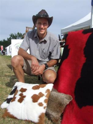 Adam Cowie, from Animal Skin Tanning Services, with some of his skins on display at the Southern...