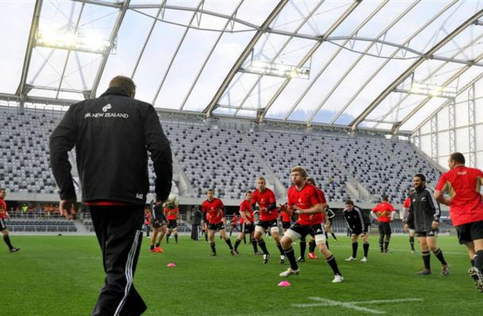 Adam Thomson (foreground centre) trains with the All Blacks at the Forsyth Barr Stadium in...
