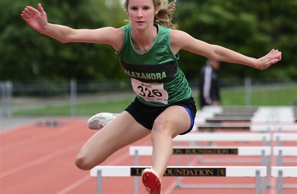 Adriana  Mawhinney  (Alexandra) wins the girls 15 and under 80m hurdles. Photos by Peter McIntosh.