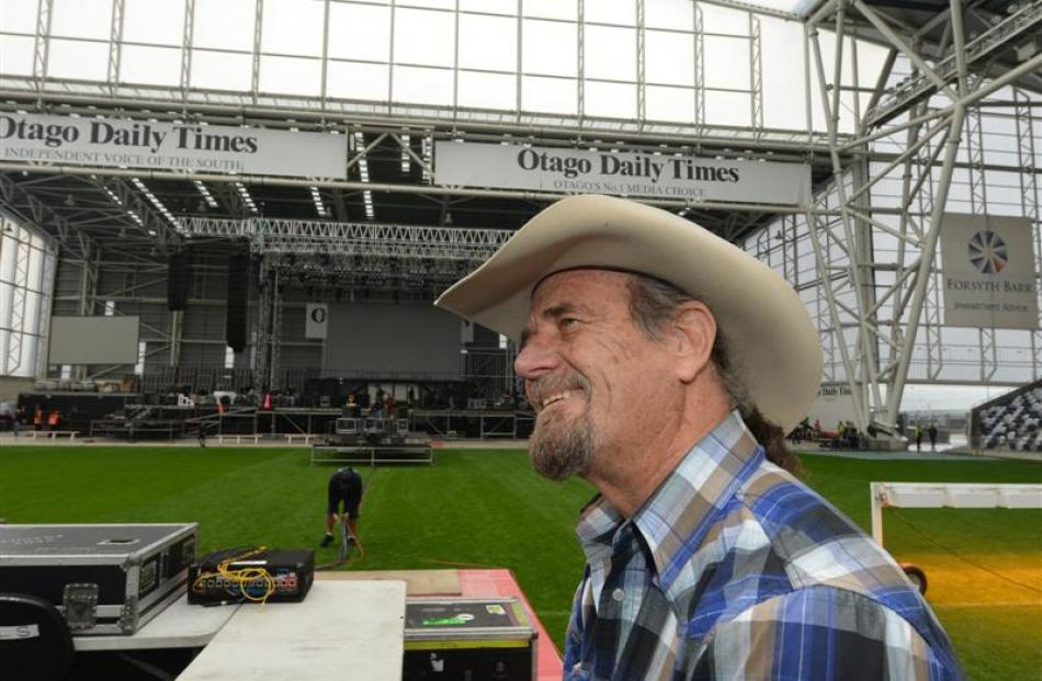 Aerosmith production manager Chris Lamb takes a break from organising the stage construction at...