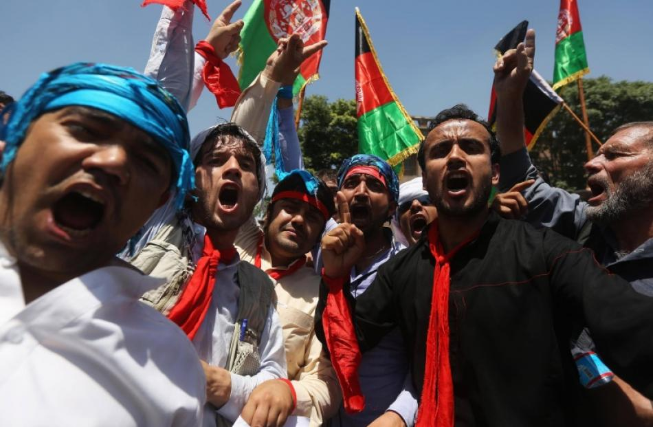 Afghans shout slogans during a protest to support presidential candidate Abdullah Abdullah, in...