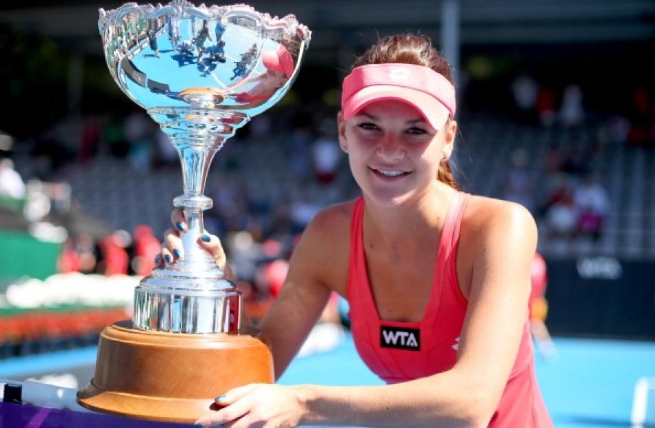 Agnieszka Radwanska of Poland holds the trophy following the final against Yanina Wickmayer of...