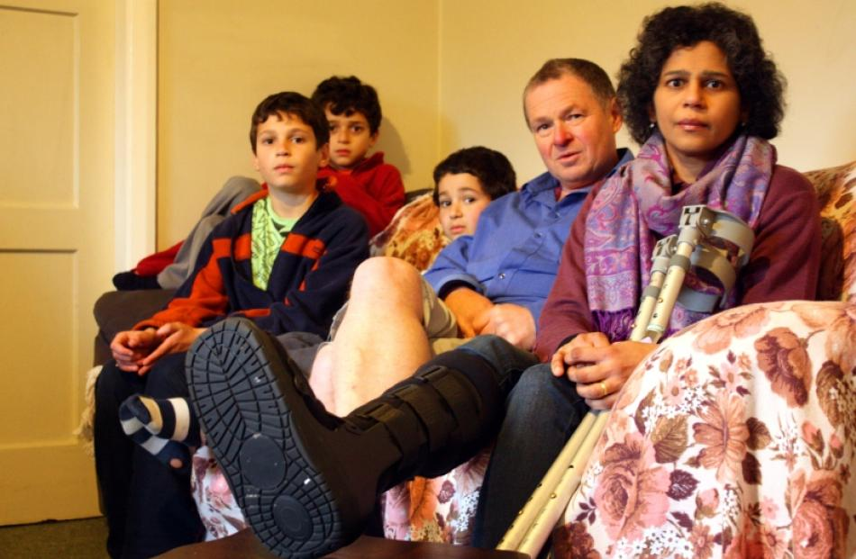 Ahila James recovers at home with her family (from left) Abihinath Berry (12), Vis Berry (11),...