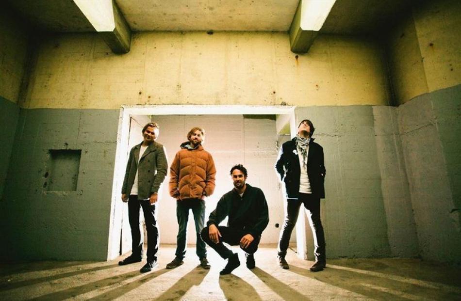 The Julian Temple Band (from left) Alex Vaatstra, Paul McLennan-Kissel, Julian Temple and Paul...