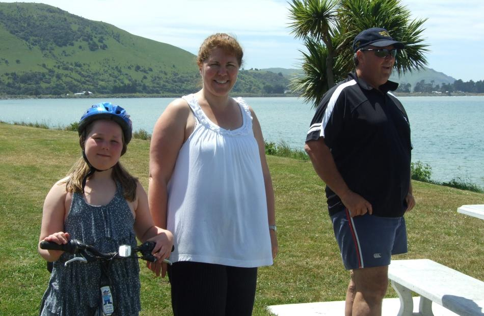 Alex (8), Kerren and Jim Crawford enjoy one of the stunning views at Pounawea. Photos by Helena...