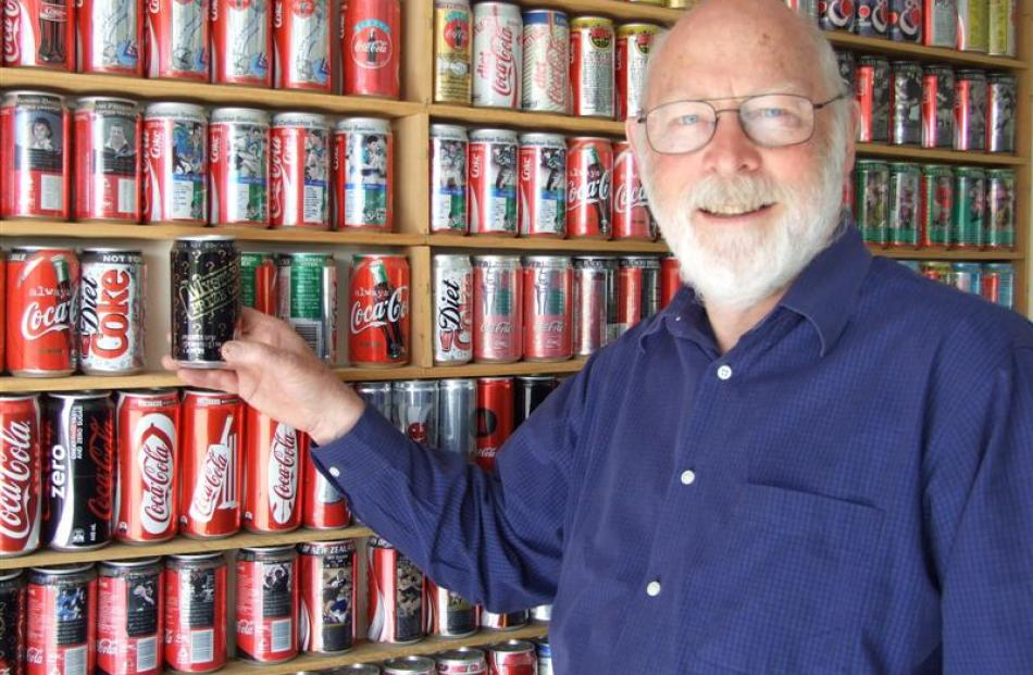 Alexandra man Rory Butler with some of his 300-strong collection of New Zealand-produced Coca...