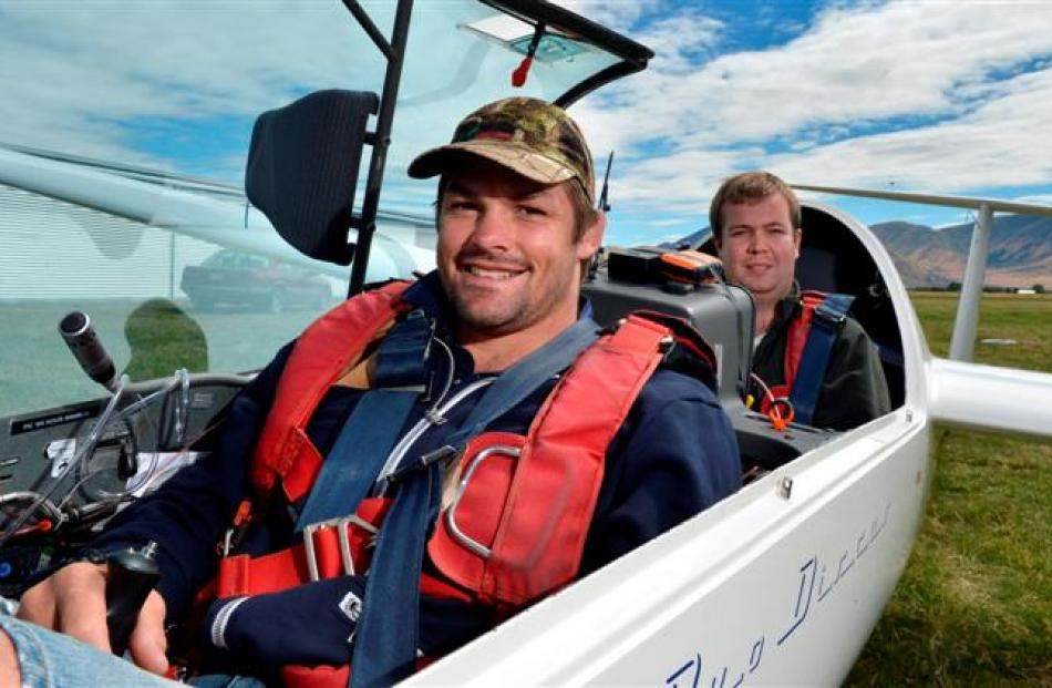 All Black captain Richie McCaw and  his cousin, Alex McCaw, prepare for a flight in the national...