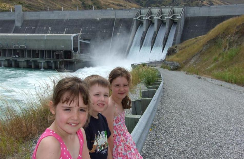 All four spillways were open yesterday  on the Clyde Dam and holiday-makers (from left) Catherine...