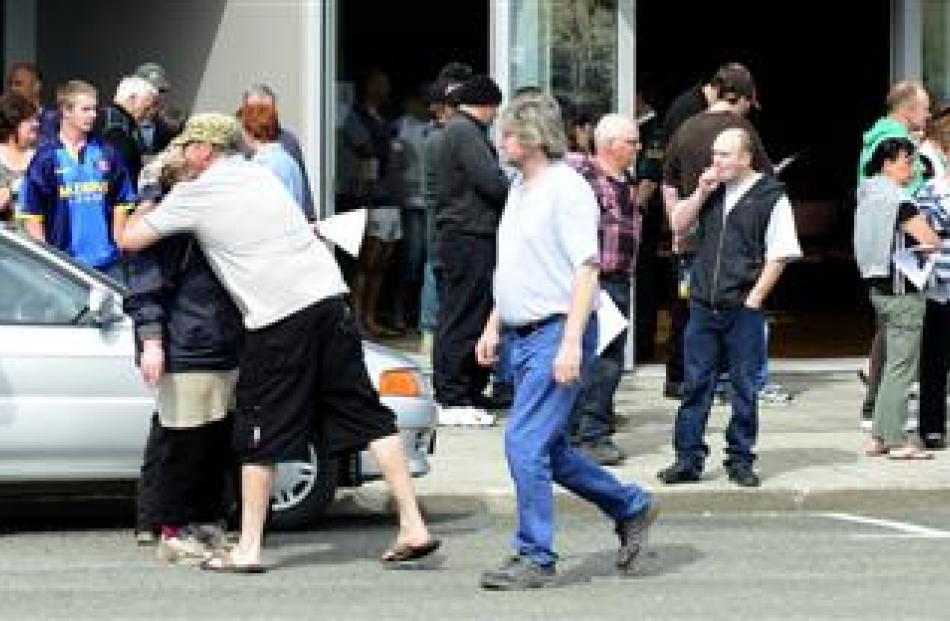Alliance Group meatworkers spill on to the street outside the Mataura Community Centre yesterday...