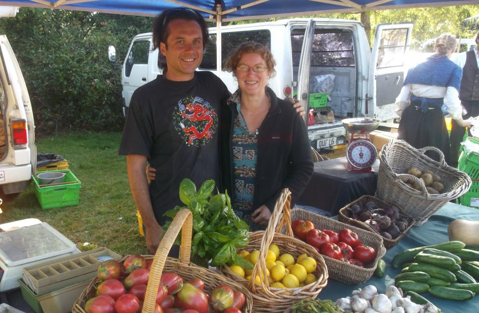 Amberley lifestylers Lorraine Liddle and Gianni Prencipe sell vegetables from their stall at the...
