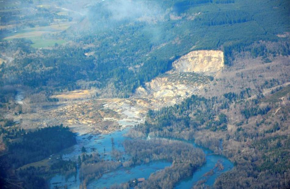 An aerial view shows the damming of the Stillaguamish River after the landslide in Oso.   REUTERS...