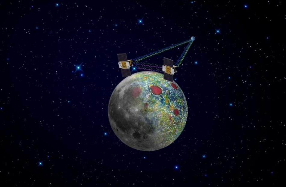 An artist's rendering of twin GRAIL spacecraft in orbit around the moon is shown in a NASA...