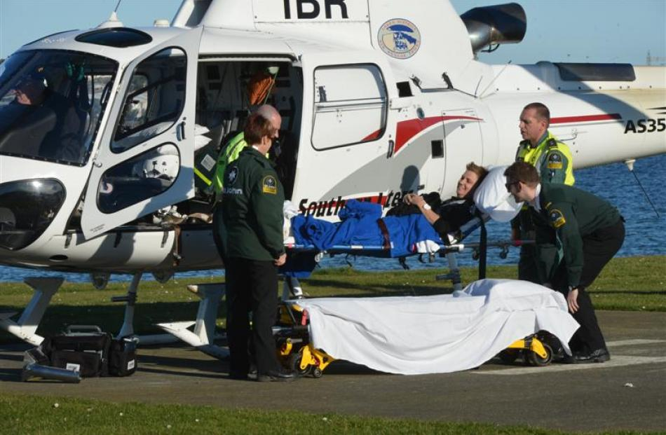 An injured skier is transferred at the Kitchener St helipad in Dunedin on August 4. Photo by...