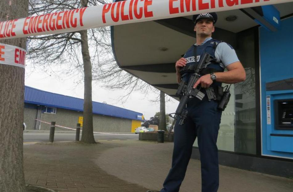 An officer near the Ashburton Work and Income office. Photo by Ashburton Courier.