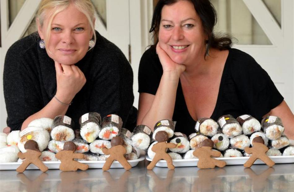 Angela Howell (left) and Nickee Blucher with their sushi and gingerbread men bound for Dunedin...