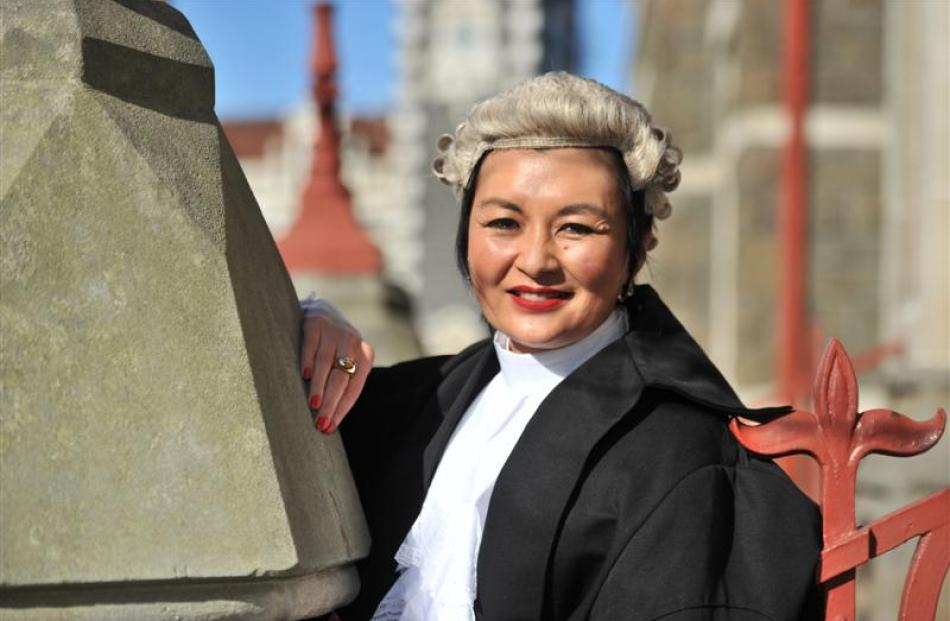 Anita Chan is all smiles after her silks ceremony in the High Court at Dunedin yesterday. Photo...