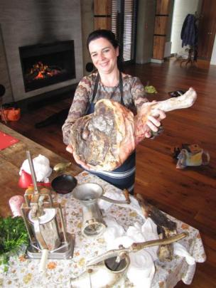 Anna Mahy displays a ham she cured  using a centuries-old recipe. Photos by Mark Price.