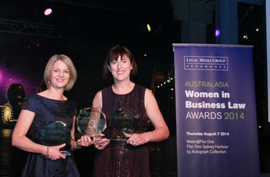 Anne McLeod (left), of Dunedin, and Kerry O'Donnell, of Queenstown, show off the trophies won by...