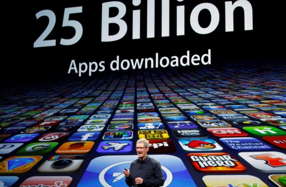 Apple CEO Tim Cook speaks about the number of Apps downloaded during a March 2012 event in San...