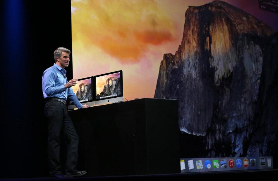 Apple vice president of software engineering Craig Federighi demonstrates the new Yosemite...