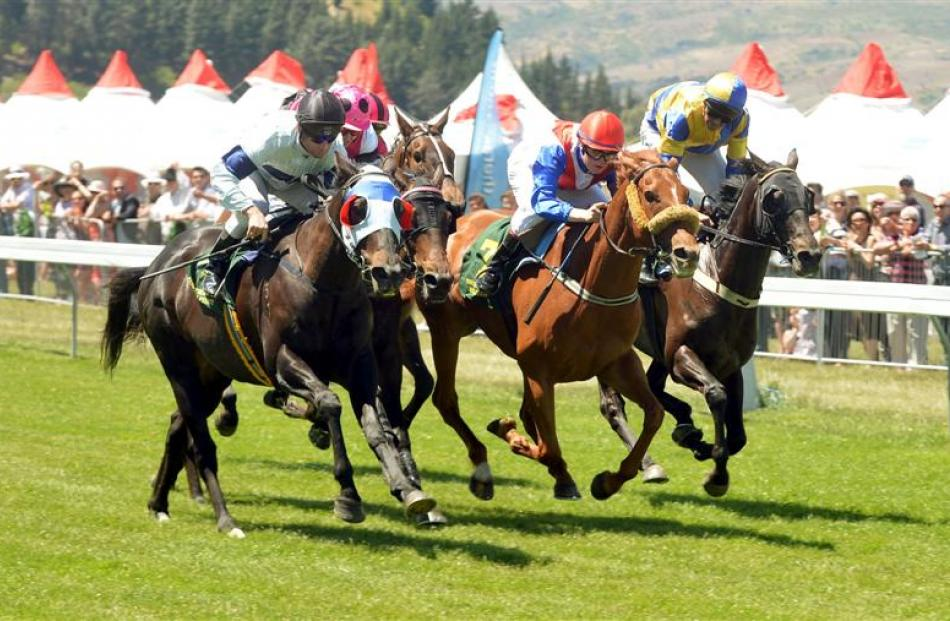 Apprentice Ashley Frye urges  Gallant Babe (second from right)  on  to win at Cromwell yesterday....