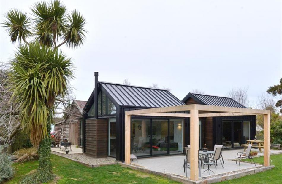 Architectural designer Reece Warnock has built his family home around a 19th-century Outram...