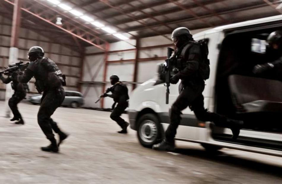 Armed offenders squad members take part in a training exercise. Photos by NZ Police.