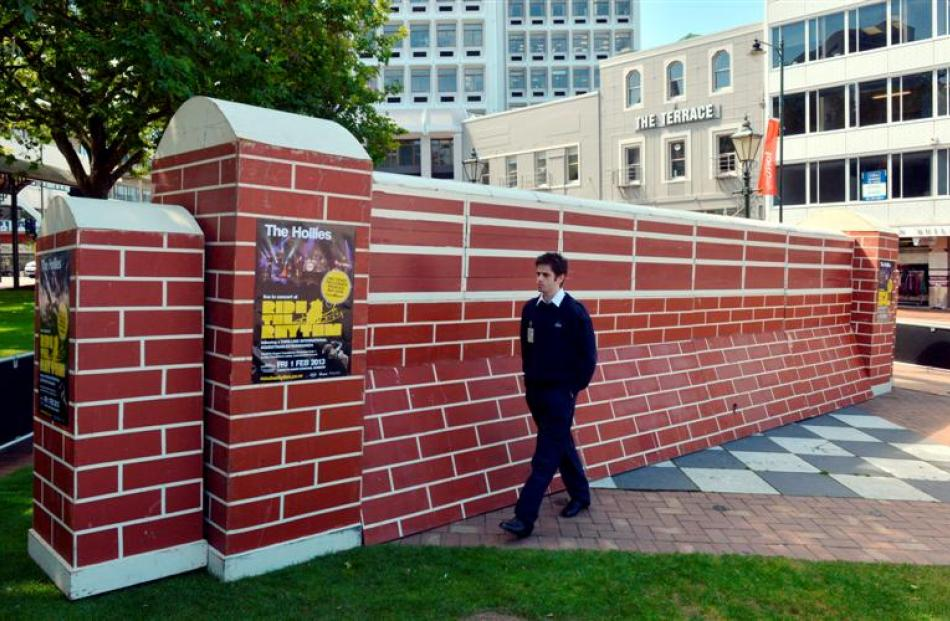Armourguard security officer Dane Crosland  guards the record-setting equestrian jump in the...