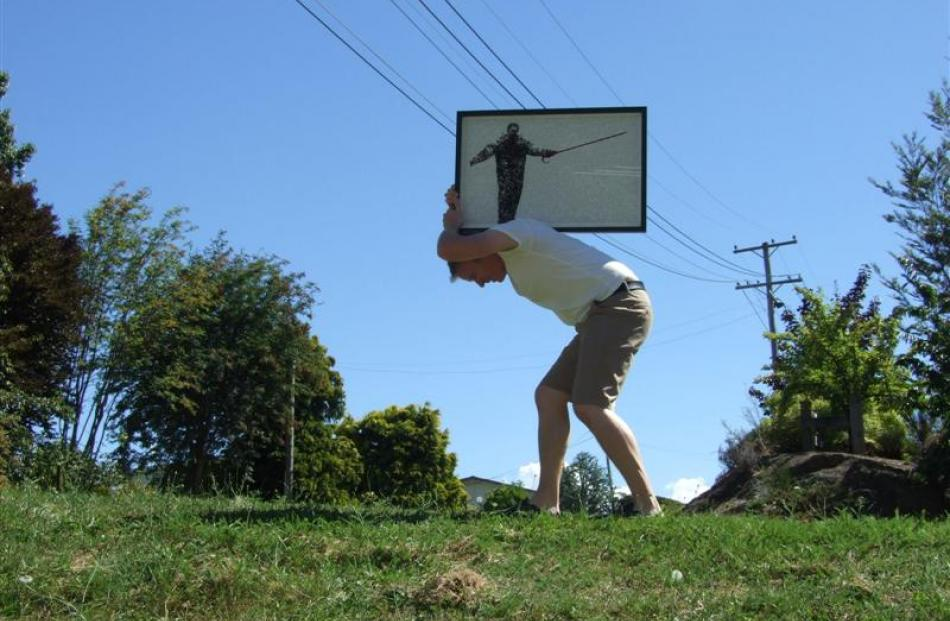 Arrowtown artist Paul Sewter replicates Sisyphus, from Greek mythology but instead of a boulder,...