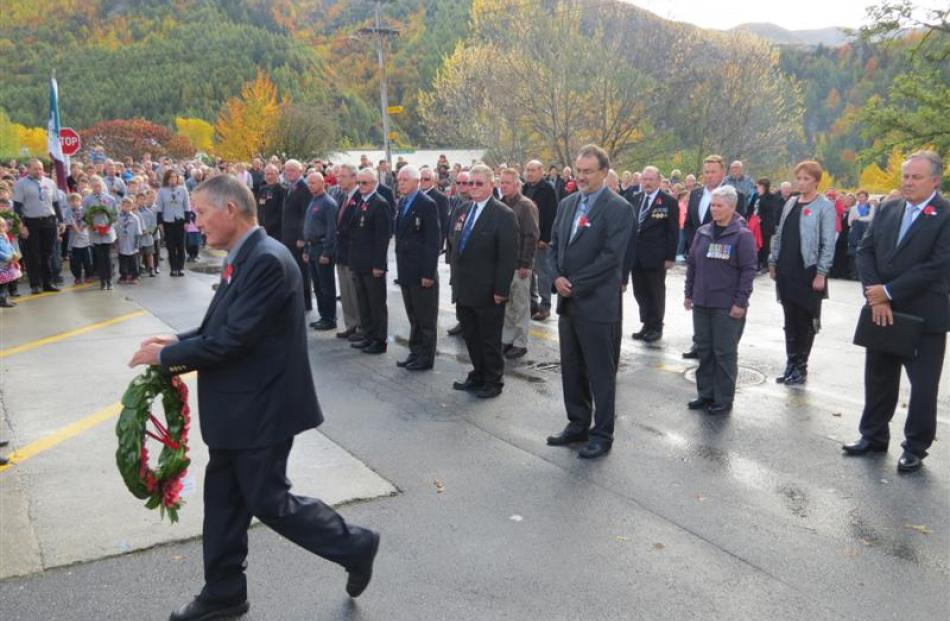 Arrowtown RSA president John Lindsay lays a wreath  at the Arrowtown and District War Memorial ...